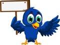Cute blue bird cartoon holding blank board Royalty Free Stock Photo
