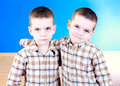 Cute blue-eyed children posing Stock Images