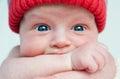 Cute blue-eyed infant with wide eyes otkoytymi Royalty Free Stock Photo