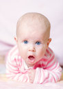 Cute blue eyes baby girl with big lying down Stock Images