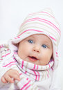 Cute blue eyes baby smiling girl portrait with big in knit hat and scarf Royalty Free Stock Image