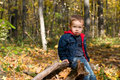 Cute boy and autumn forest Royalty Free Stock Image