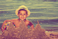 Cute boy on the beach with ball and sandcastle Stock Image