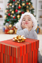Cute boy with big Christmas present Royalty Free Stock Photo