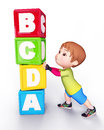 Cute boy with blocks of alphabets Royalty Free Stock Image