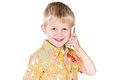 Cute boy calling on phone isolated on white Royalty Free Stock Photos