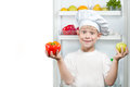 Cute boy Chef near the open refrigerator Royalty Free Stock Photo