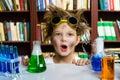 Cute boy doing biochemistry research in chemistry