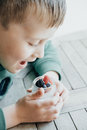 Cute Boy eating Pudding with chia seeds, yogurt and fresh fruits Royalty Free Stock Photo