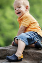 Cute boy enjoys sunny day at the playground. Stock Image