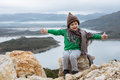 Cute boy in a funny hat sitting on a mountain. Freedom concept Royalty Free Stock Photo