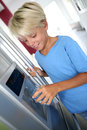 Cute boy getting fresh water Stockfoto