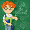 Cute boy in glasses near the blackboard banner back to school Stock Image