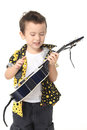 Cute boy with guitar music playing on white background Royalty Free Stock Images