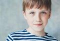 Cute boy happy beautiful closeup portrait stripes child sitting Royalty Free Stock Image