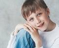 Cute boy happy beautiful closeup portrait studio child sitting Royalty Free Stock Image