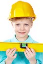Cute boy in hardhat holding a level and looking at camera Stock Photos