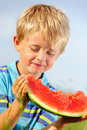 Cute boy with healthy eating habits Stock Photo