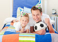 Cute boy and his father watching a football match Royalty Free Stock Images