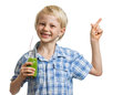 Cute boy holding green smoothie and pointing a young healthy smiling at copy space isolated on white Royalty Free Stock Image
