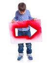 Cute boy holding red arrow