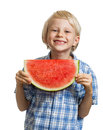 Cute boy holding slice of water melon Royalty Free Stock Photo