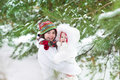 Cute boy hugging his baby sister in a winter park beautiful under big tree Royalty Free Stock Image