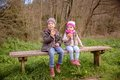 Cute boy and little girl eating muffins sitting on Royalty Free Stock Photo