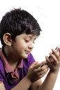 A cute boy with mobile i smiling white holding modern cell phone Stock Image