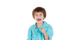 A cute boy mocking closeup portrait of adorable young pointing and laughing at you isolated on white background with copy space Stock Image