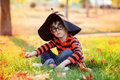 Cute boy in the park with halloween costume, hat and glasses