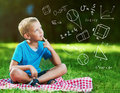 Cute boy in a park thinking Royalty Free Stock Photo