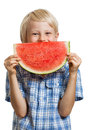 Cute boy peeking behind water melon a happy a juicy slice of watermelon isolated on white Stock Images