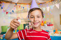 Cute boy playing with bubble wand during birthday party Royalty Free Stock Photo