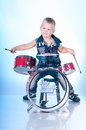 Cute boy playing the drums Stock Images
