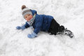 Cute boy playing in the snow Royalty Free Stock Photography