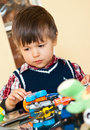 Cute boy playing with toys Stock Photo