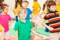 Cute boy practicing gymnastics in children`s group