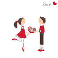Cute boy present sweets to the girl Royalty Free Stock Image