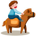 Cute boy riding horse Royalty Free Stock Photos