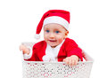 Cute boy in santa clause cap sitting in a box funny child isolated on white background Royalty Free Stock Image