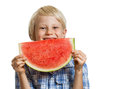 Cute boy smiling behind water melon a happy a juicy slice of watermelon isolated on white Royalty Free Stock Photography