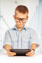 Cute boy with tablet isolated happy this image has attached release Stock Photography