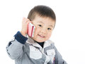 Cute boy talk to phone and isolated on white Stock Images