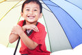 Cute boy under umbrella Royalty Free Stock Photos