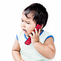 Cute Boy Using Mobile Phone Royalty Free Stock Photo