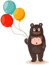 Cute boy wearing bear suite with balloons