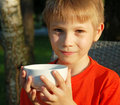 Cute boy with white cup handsome Stock Photography