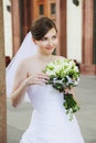 Cute bride with flowers looking sideways Stock Image