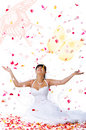 Cute bride throws rose petals and butterflys Stock Photo